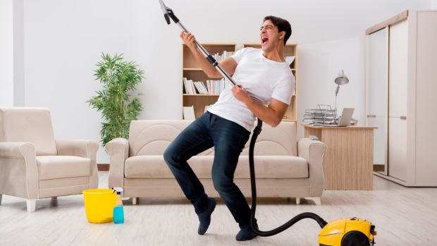 519407452-man-happy-to-be-vacuuming