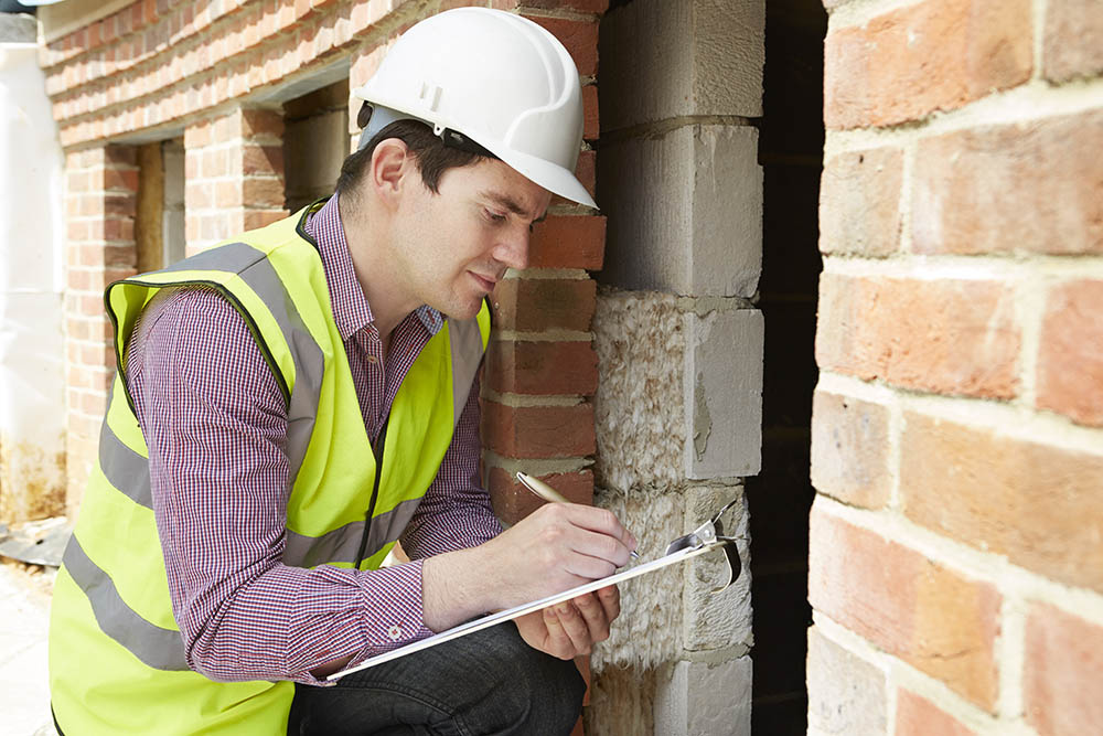 Architect Checking Insulation During House Construction; Shutterstock ID 202741987; PO: Jessica Rourk; Job: Blog